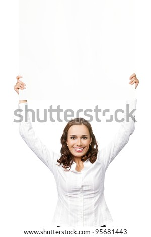 Happy smiling young business woman showing blank signboard, placard or banner, isolated over white background - stock photo
