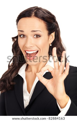 Happy smiling young business woman showing okay gesture, isolated on white background