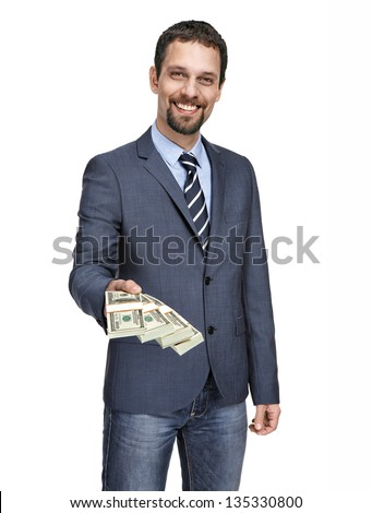 happy smiling young businessman in a suit jacket giving stack of one hundred dollar bills into the camera isolated on white background