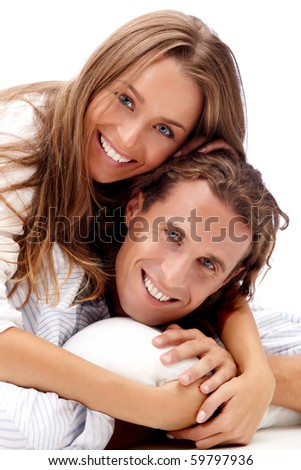 Happy smiling young couple isolated on white