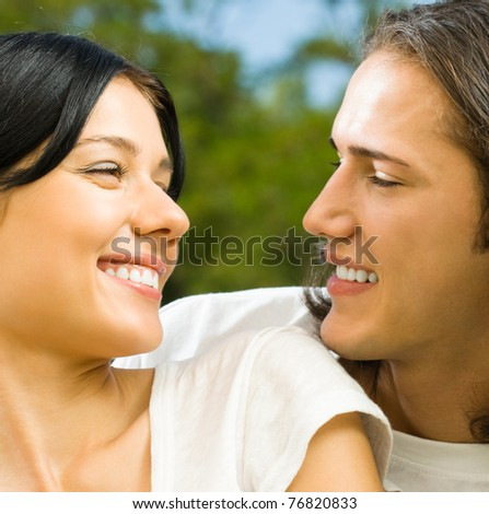 Happy smiling young couple on romantic date outdoors