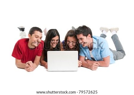 Happy smiling young group of friends watching and working together at laptop isolated on white background