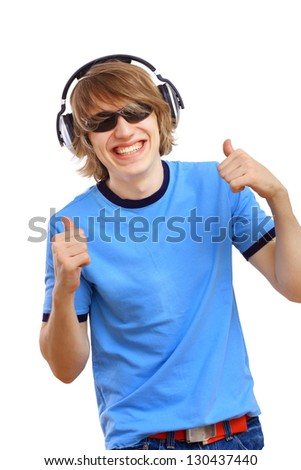 Happy smiling young man dancing and listening to music - stock photo