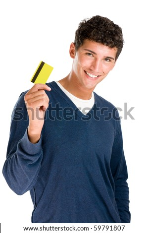 Happy smiling young man showing credit card isolated on white background