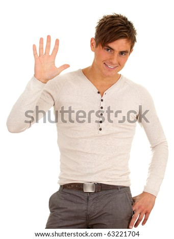 happy, smiling young man with raised arm, waving hello