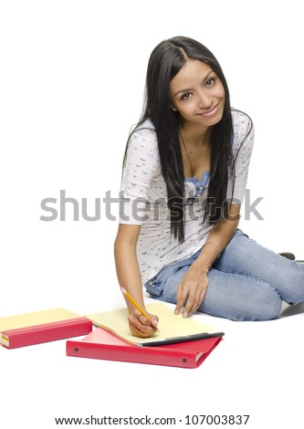 Happy smiling young student doing homework.  Image isolated against white background