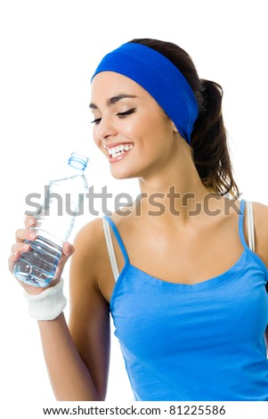 Happy smiling young woman in sportswear drinking water, isolated on white background
