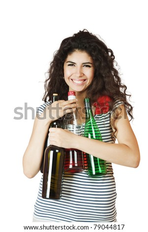 Happy smiling young woman with bottles of wine