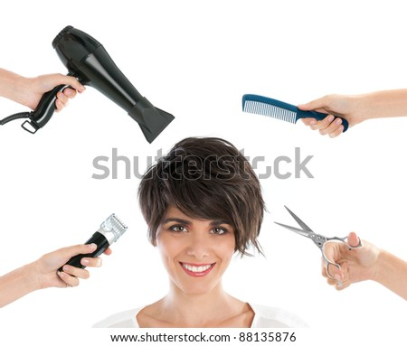 Happy smiling young woman with hairdresser tools among her isolated on white background