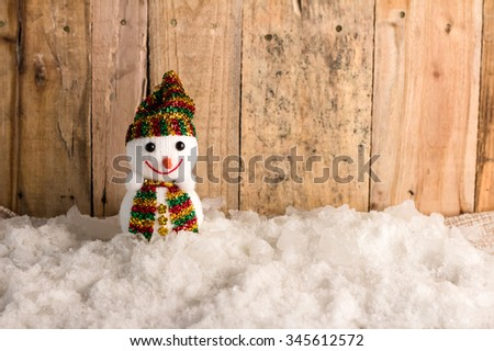happy snow ball  on snow and wooden background