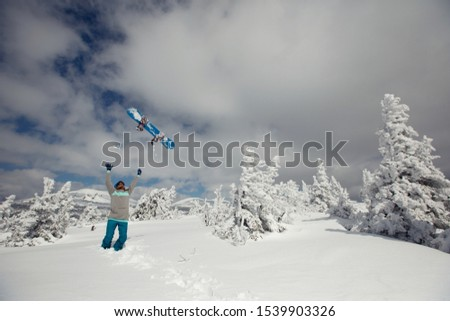 Happy snowboarder in winter snowy forest, frozen trees, sunny day #1539903326