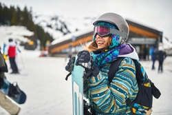 Happy snowboarder on the mountain.Winter sport.