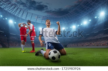 Happy soccer player celebrate a victory on a professional football stadium