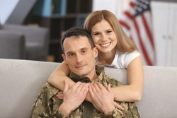Happy soldier and his wife at home