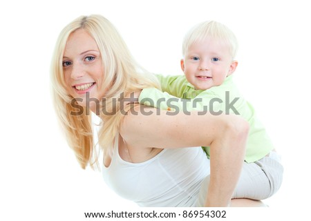 Happy son sitting on mother's back looking directly to camera. Studio shot isolated.
