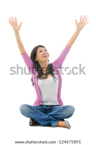 Happy Southeast Asian Chinese woman arms opened looking up. Full body sitting on white background