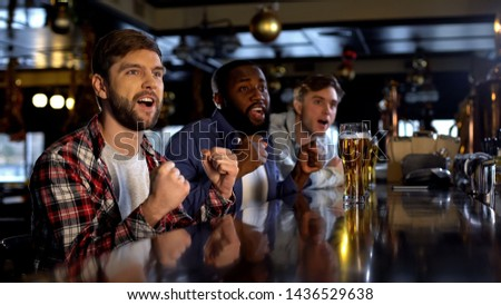 Happy sport fans watching tournament in pub, cheering for favorite team, victory #1436529638