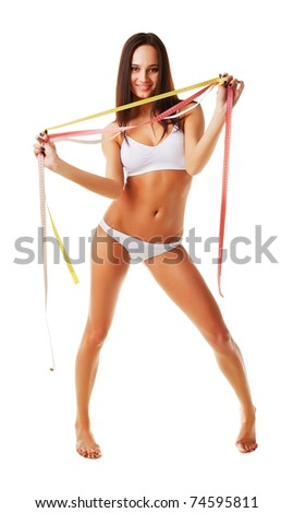 Happy sporty woman with measures on white background