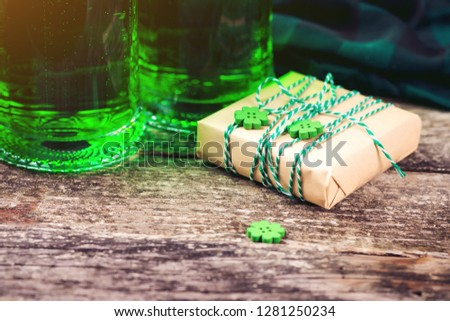 Happy st. Patrick's day. Card with beer and lucky clover. Saint Patrick's day holiday celebration. Irish festival symbol. Lucky concept. St. Patrick's day background with gift. Copy space.