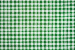 Happy St. Patrick's day. Gingham pattern in green and white, closed up texture of green and white for background. Picnic table cloth.