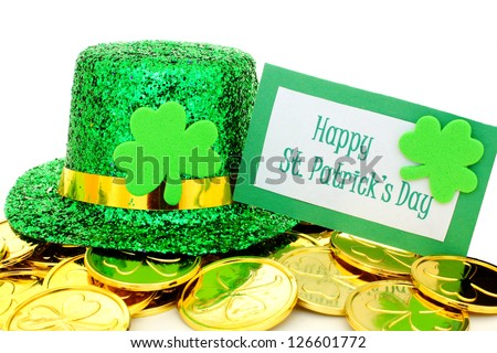 Happy St Patrick's Day tag with party hat and gold coins over white