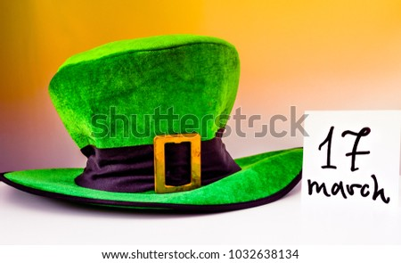 Happy St Patricks Day, green hat and sticker with the date of March 17th