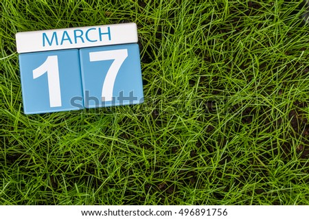 Happy St Patricks Days save the date. March 17th. Day 17 of month, calendar on football green grass background. Spring time, empty space for text