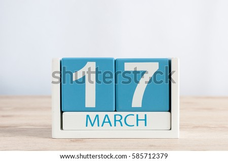 Happy St Patricks Days save the date. March 17th. Day 17 of month, daily calendar on wooden table background. Spring time, empty space for text