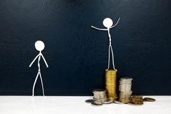 Happy stick man figure standing on a pile of coins beside a sad envious one. Rich versus poor and income inequality concept.