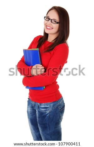 Happy student girl wearing jeans, red blouse and black glasses is holding folders. Isolated on the white background.