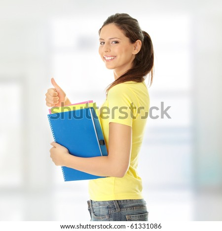 Happy student girl with thumb up