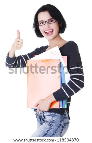 Happy student woman with notebooks showing ok gesture, isoalted on white background
