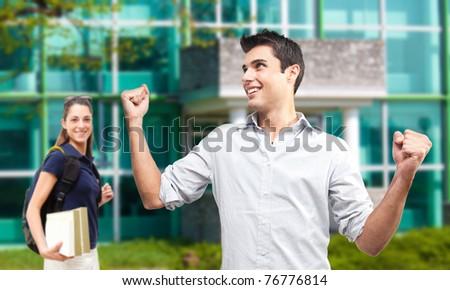 Happy students outside of a modern school