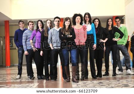 happy students people group portrait at university  indoor building