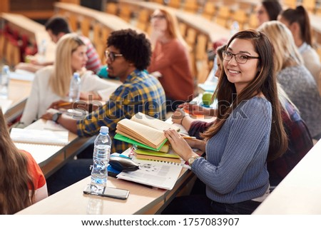 Happy students smiling on lecture in amphitheater Сток-фото ©