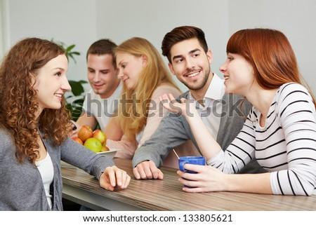 Happy students taking a coffee break in break room