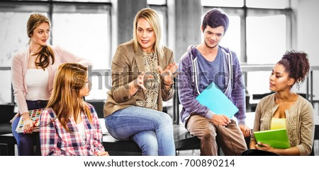 Happy students talking with their teacher in library ストックフォト ©