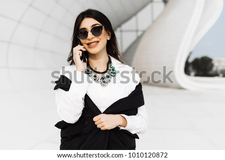 happy stylish, business woman speaks by phone