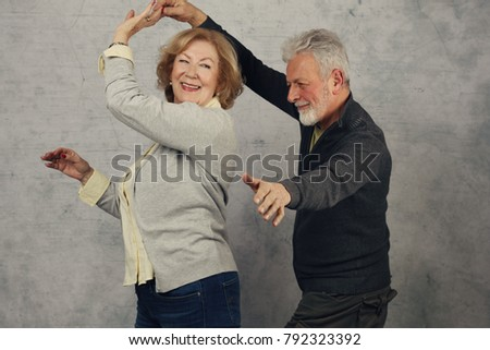 Happy stylish elderly couple dancing and laughing. Vintage image #792323392