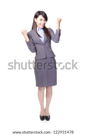 Happy Success winner business woman celebrating with her arms up and show fist in full length isolated over a white background, asian beauty model