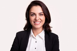 Happy successful adult business lady in formal black jacket and white shirt looking at camera and smiling against white background