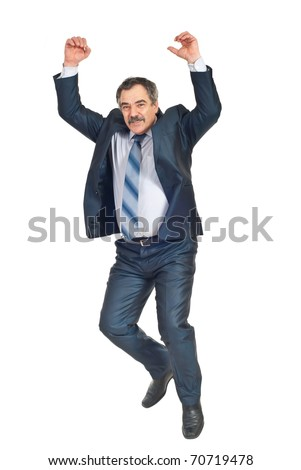 Happy successful business man jumping with arms raised isolated on white background