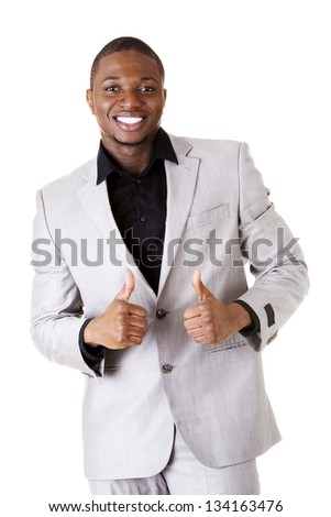 Happy successful businessman gesturing OK - thumbs up. Isolated on white.