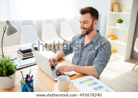 happy successful businessman working in office on laptop #493678240