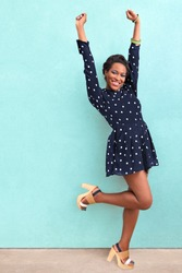 Happy summer African black woman in dress and sandals with copy space