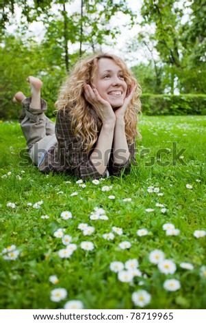 Happy surprised woman on flower field looking up