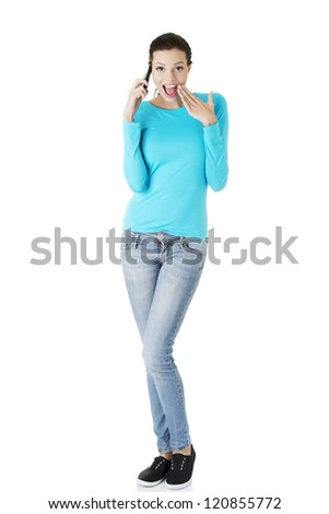 Happy surprised woman with cell phone, isolated on white