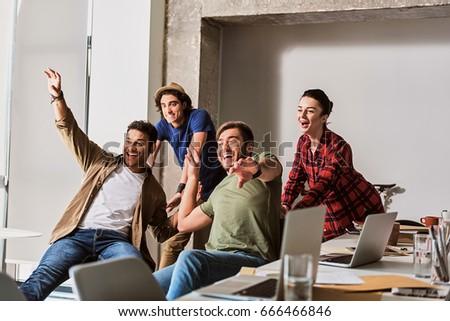 Happy team celebrating success in work