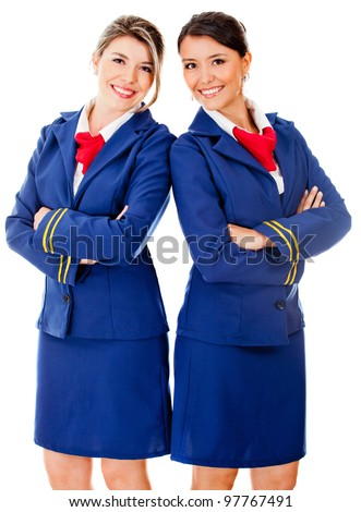 Happy team od flight attendants smiling - isolated over a white background