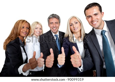 Happy team of business colleagues gesturing a thumbs up sign on white
